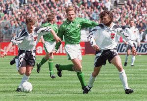 Tommy Coyne battles for possession v Austria at Lansdowne Road.